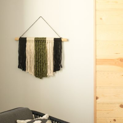 If you're looking for a quick and easy way to fill a blank space on your wall and make a statement, this modern DIY yarn wall hanging is perfect! It's so simple and only takes about 20 minutes start to finish!