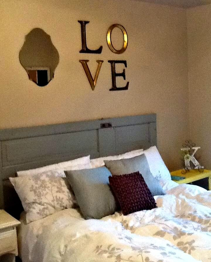 how to decorate above a headboard