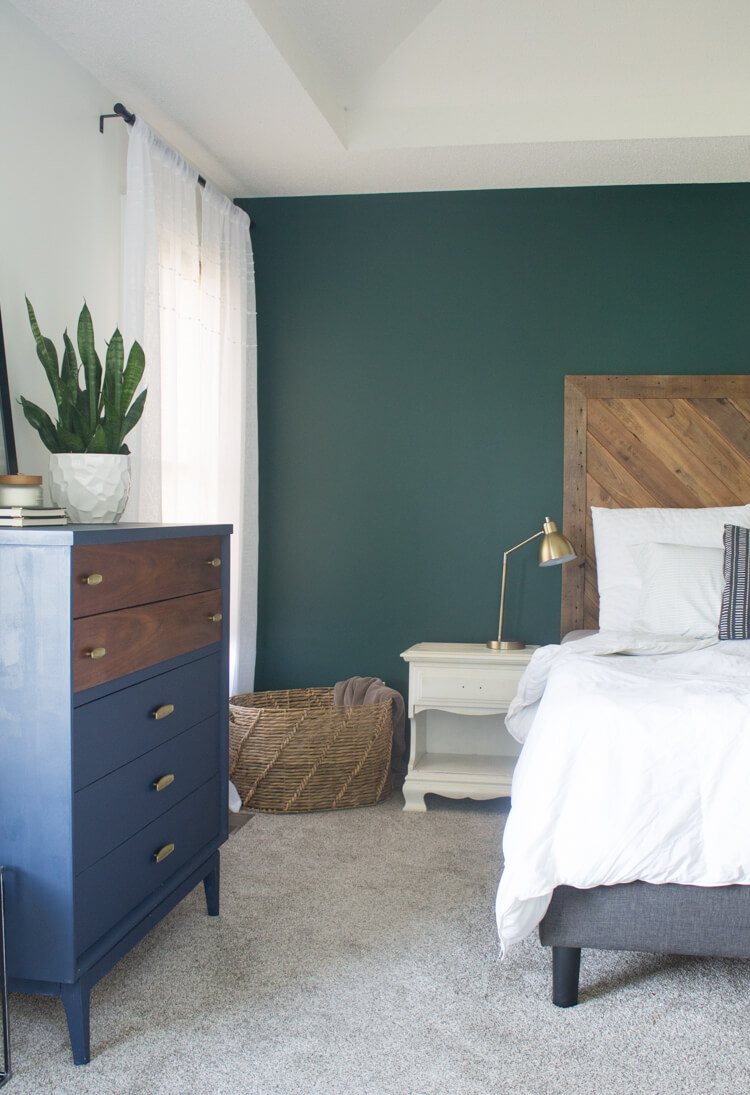 How to decorate your bedroom for better sleep: Dark calming wall colors like this dark green help us relax for a better nights sleep.