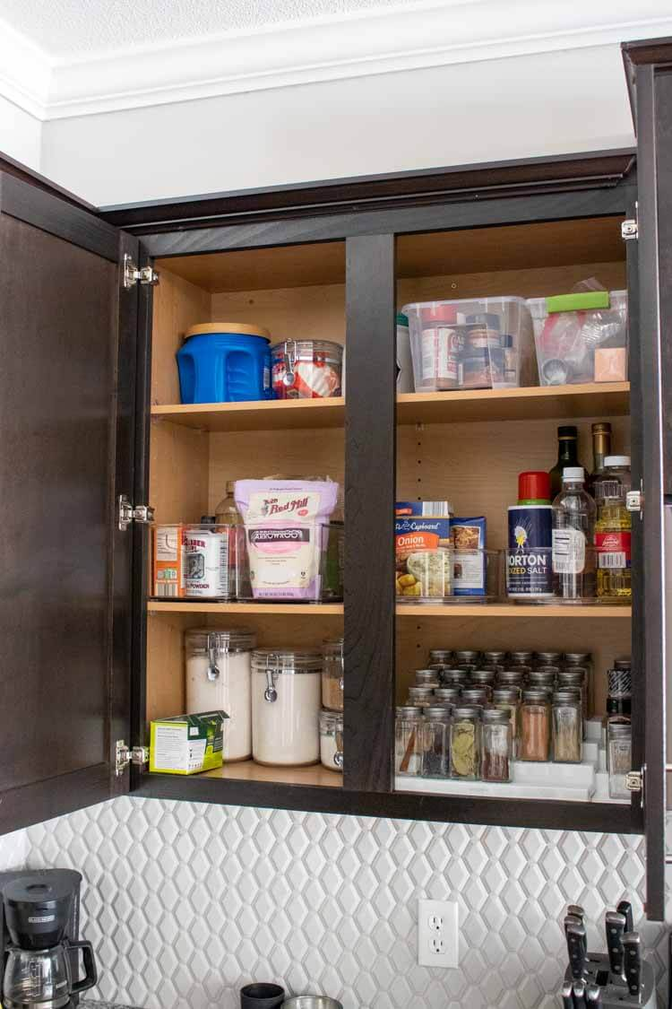 Organized spice cabinet with acrylic organizers from Amazon