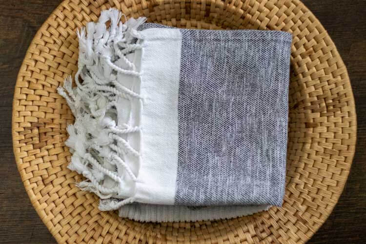 pile of turkish towels in basket - ditch the paper towels and use washable towels