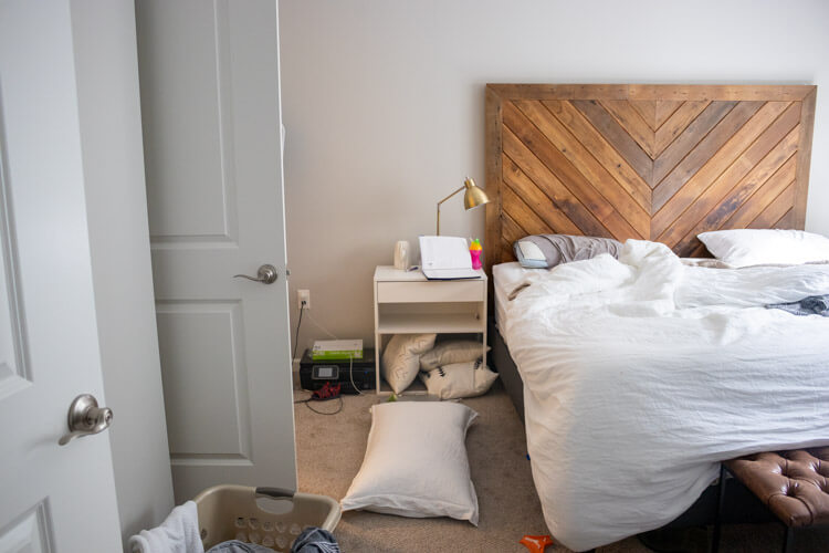 Real life home tour: how my minimalist apartment really looks. This is our messy bedroom.
